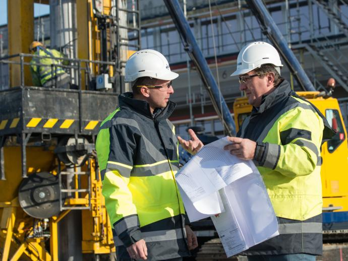 Employees on site discussing project